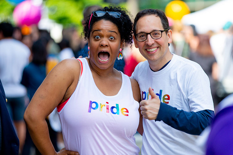 Microsoft employees Tiernan Madorno on the left and Chris Capossela on the right, at the Seattle Pride celebration. Photo by Scott Eklund, redboxpictures.