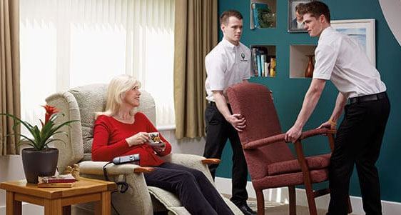 Oak Tree mobility staff providing an elderly lady with a more comfortable chair.