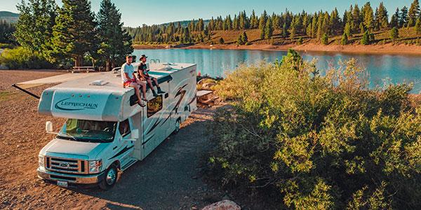 Image of a RVshare rental RV lakeside.