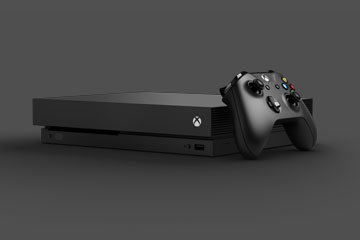Xbox One X gaming console and controller.
